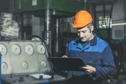 Maintenance Technician holding Tablet